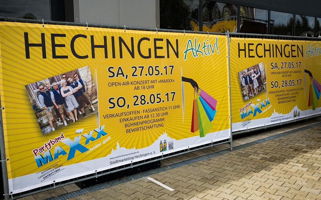 Bannerwerbung an einem Bauzaun für die Stadt Hechingen